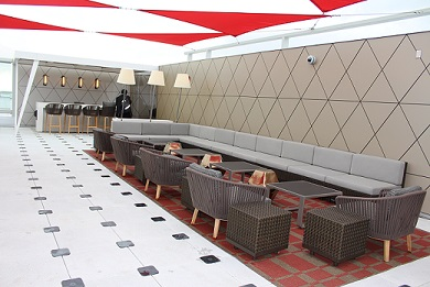 Delta Air Lines' first outdoor airport terrace, called The Sky Deck.  Delta partnered with Architectural Digest and interior designer Thom Filicia for this beautiful deck.