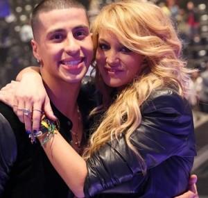 Contestant Carlito Olivero with Coach Paulina Rubio