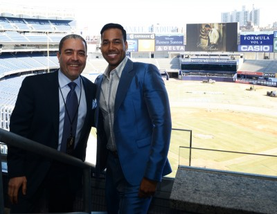 Businessman Félix Cabrera, singer Romeo Santos and executives of the Yankees Corporation