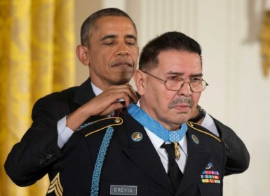 President Barack Obama awards Army Spc. Santiago Erevia the Medal of Honor during a ceremony in the East Room of the White House.