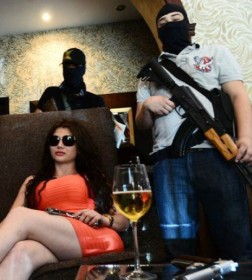 Photo of Claudia Ochoa Felix, or La Emperatriz, the alleged new leader of Los Ántrax surrounded by armed men.
