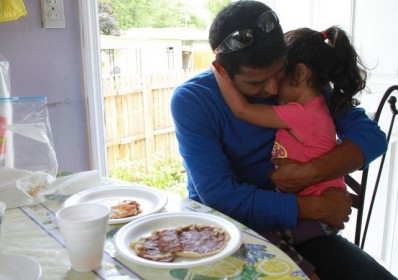 Luis Fuentes (L.) holds daughter, Janie. Fuentes is on an self-fueled investigation to find his wife.