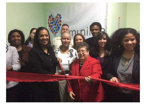 Life is Precious founder, Dr. Rosa María Gil, (c., in red) Councilmember Julissa Ferreras (l., with scissors) and staff, parents and students at ribbon-cutting ceremonies at the suicide prevention program's new Queens facility in Long Island City.
