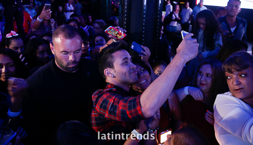 Prince Royce taking selfies with fans