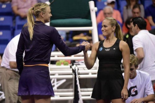 maria-sharapova-gets-beaten-by-monica-puig-in-an-exhibition-match